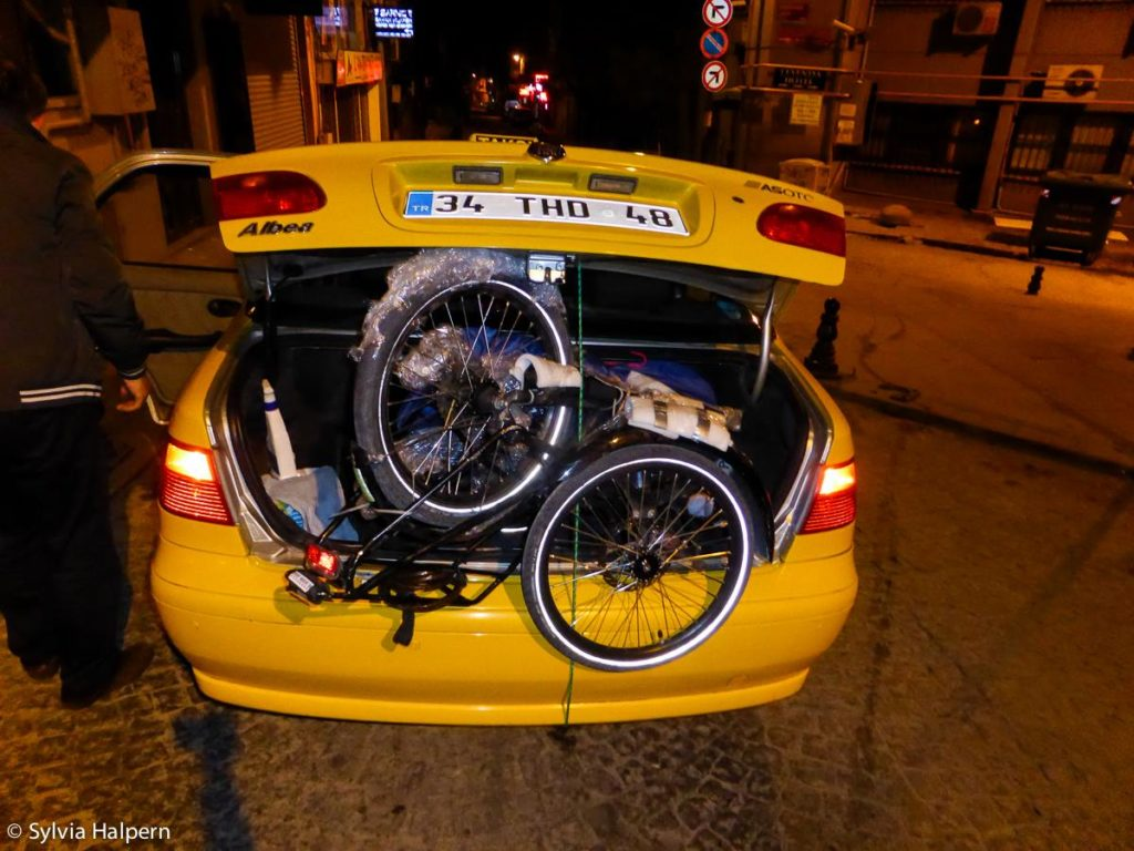 Packed in the taxi while touring Turkey by bike